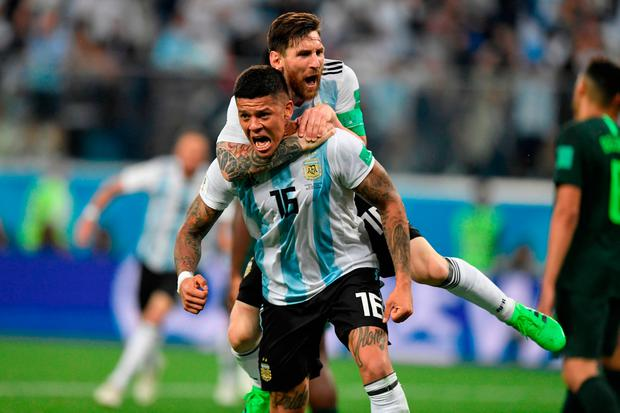 Marcus Rojo celebrates his dramatic late winner in Argentina's 2-1 victory over Nigeria with Lionel Messi. Photo: AFP/Getty Images