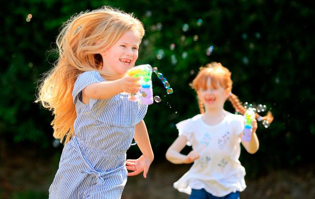 Lucy McAdam (6) and Gemma Mooney (7), from Hollystown, have fun in the sun with their bubble guns. Photo: Gerry Mooney