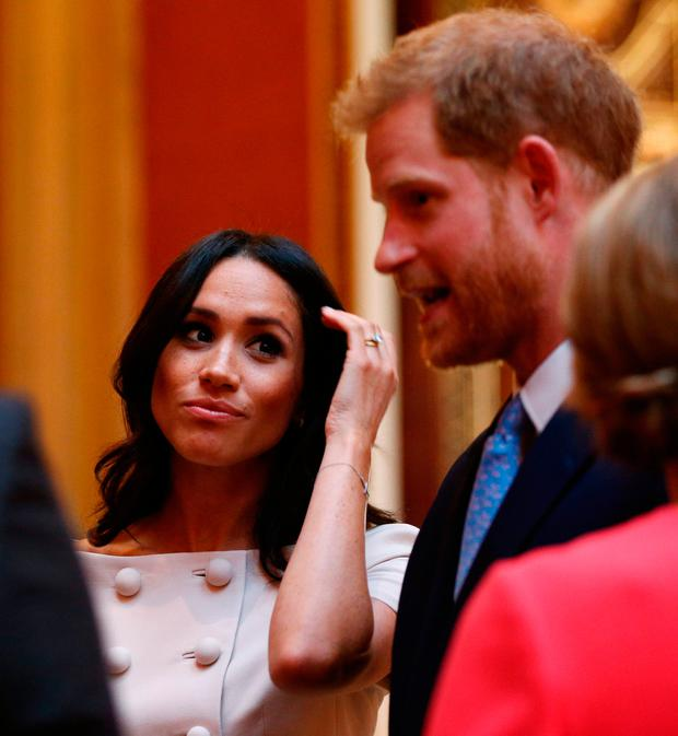 Meghan Duchess of Sussex and Prince Harry Duke of Sussex meet group of leaders during the Queen's Young Leaders Awards Ceremony at Buckingham Palace