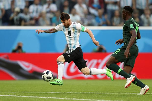 With his second touch, Messi takes the ball away from closing defender Kenneth Omeruo. Photo: Patrick Smith/Fifa