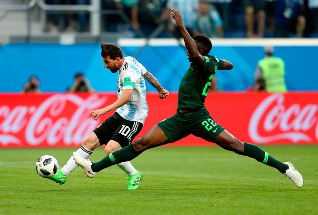 Despite the Nigerian defender's best efforts, he can't get close enough to prevent Messi finding the net with his third touch. Photo: Gabriel Rossi/Getty