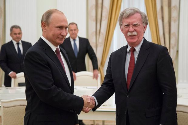 Vladimir Putin and John Bolton meet in Moscow: Photo: AP