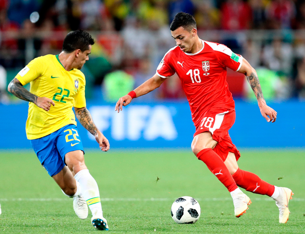 Serbia's Nemanja Radonjic is tracked by Brazil's Fagner. Photo: Getty Images
