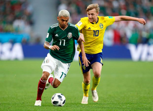Sweden's Emil Forsberg challenges Mexico's Jesus Corona. Photo: Getty Images