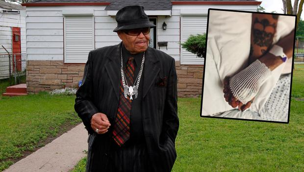 Joe Jackson tours the his family home in Gary, Indiana in 2010, left, and Paris Jackson shares this photo holding his hand on Instagram, right