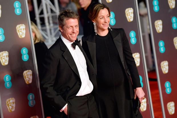 Hugh Grant and Anna Eberstein attend the EE British Academy Film Awards (BAFTA) held at Royal Albert Hall on February 18, 2018 in London, England. (Photo by Jeff Spicer/Jeff Spicer/Getty Images)