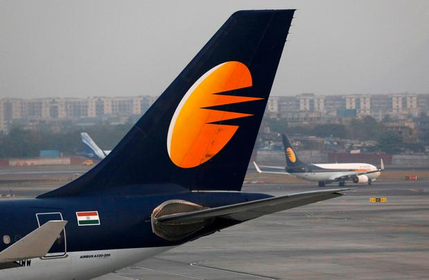 A Jet Airways plane is parked as other moves to runway at the Chhatrapati Shivaji International airport in Mumbai, India, February 14, 2018. REUTERS/Danish Siddiqui/File Photo