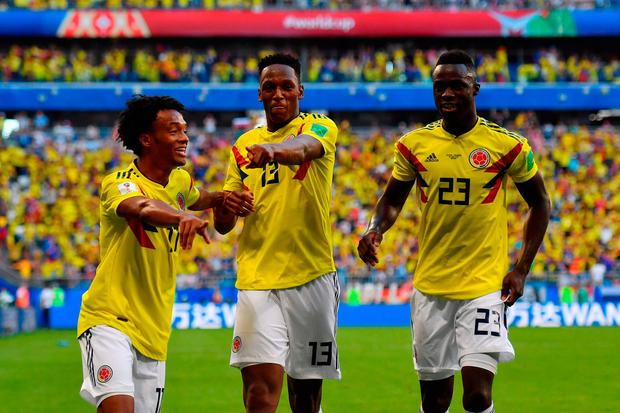 Colombian defender Yerry Mina celebrates with teammates after scoring a goal during the Russia 2018 World Cup Group H football match between Senegal and Colombia.