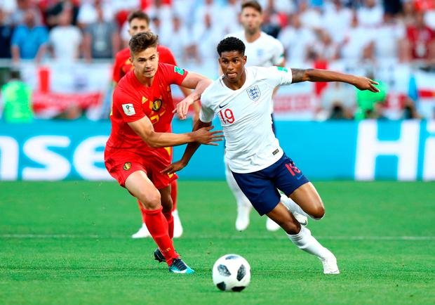 Marcus Rashford of England is challenged by Leander Dendoncker of Belgium during the 2018 FIFA World Cup Russia Group G match.