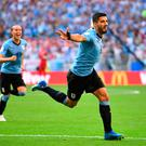 Luis Suarez celebrates after putting Uruguay into the lead in their final group game against Russia. Photo: REUTERS/Dylan Martinez