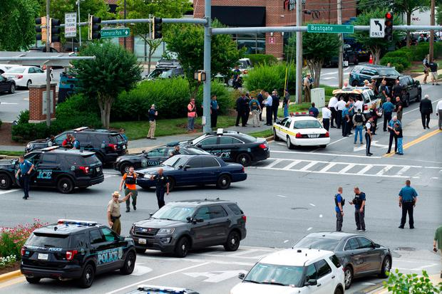 Maryland police officers block the intersection at the building entrance, after multiple people were shot at a newspaper in Annapolis: (AP Photo/Jose Luis Magana)