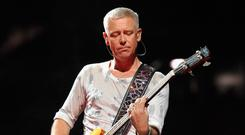 Adam Clayton performs at the New Meadowlands Stadium in New Jersey. Picture: Getty