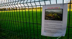 A poster opposing the development hangs on railings at the site. Photo: Doug O'Connor