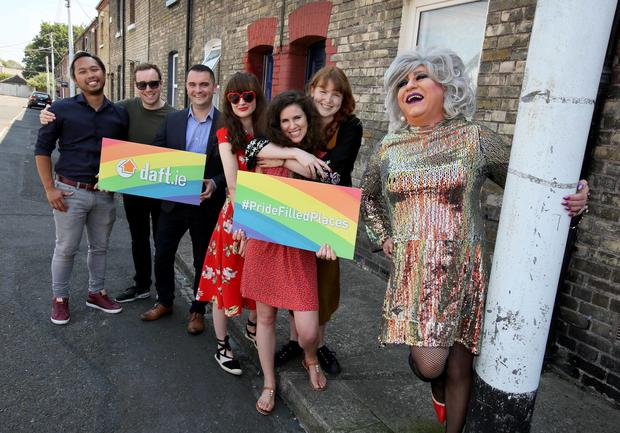 (From left to right) Daft.ie's Alex Geronimo, Brian Allen, Martin Clancy, Sarah Downey, Sonia O'Sullivan, and Rachel O'Connell with Dolly Grip in Stoneybatter. Photo: Daft.ie