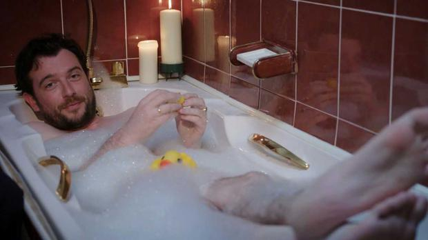 Kevin McGahern relaxing in the bath with his rubber ducks