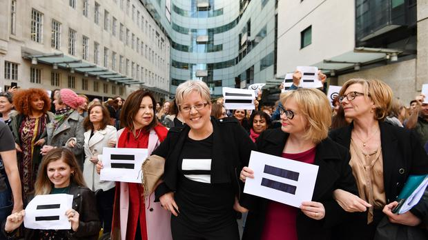 Journalist Carrie Gracie (centre) and BBC employees gather outside Broadcasting House in March (John Stillwell/PA)