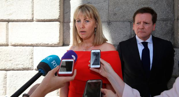 Emma Mhic Mhathuna, from Baile na nGall, Co. Kerry pictured speaking to the media on leaving the Four Courts - after the settlement of a High Court action, also in pic, her solicitor, Cian O Carroll. Photo: Collins Courts