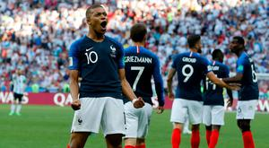 France's Kylian Mbappe celebrates after scoring his side's third goal