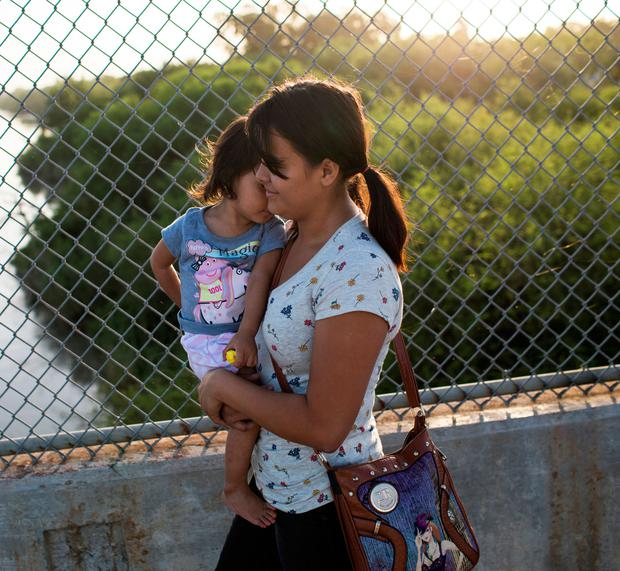 A mother and daughter in Mexico last week after being denied entry to the US. Photo: Getty