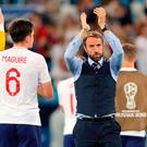 England manager Gareth Southgate applauds fans after the defeat by Belgium. Photo: PA