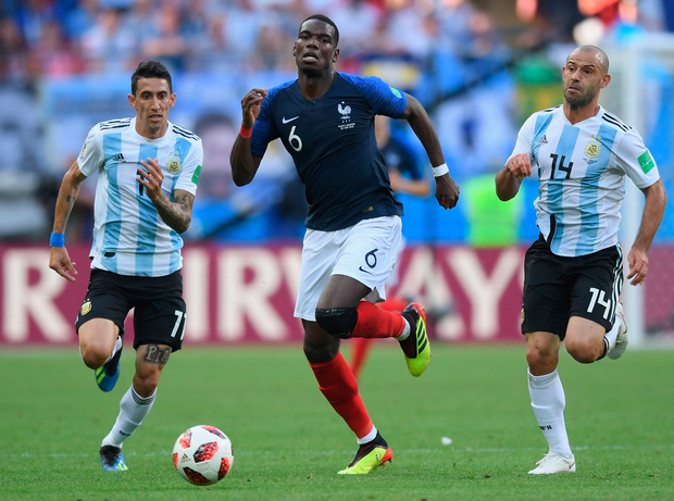 France's Paul Pogba breaks away from Argentina's Angel Di Maria and Javier Mascherano. Photo: Getty Images