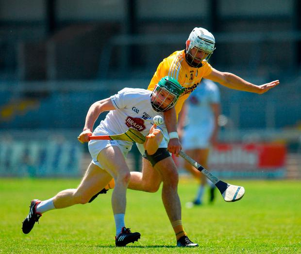 Chris Bonus of Kildare in action against Neil McManus of Antrim. Photo: Seb Daly/Sportsfile