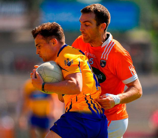 Éimhín Courtney of Clare in action against Brendan Donaghy of Armagh. Photo: Seb Daly/Sportsfile