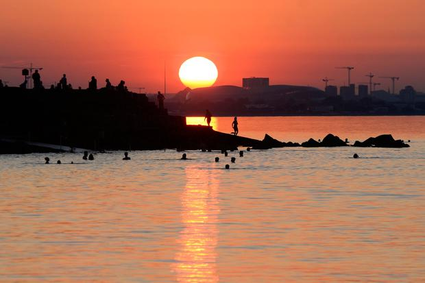 The sun sets over Dublin bay during the Heatwave in Ireland. Photo: Justin Farrelly.