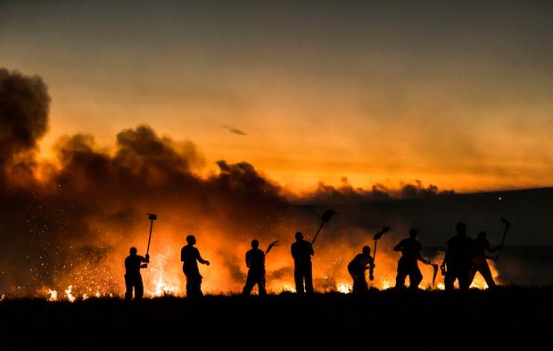 Firefighters tackle a wildfire on Winter Hill near Bolton. PRESS ASSOCIATION Photo. Picture date: Thursday June 28, 2018. See PA story FIRE Saddleworth. Photo credit should read: Danny Lawson/PA Wire