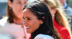 Meghan, Duchess of Sussex meets the public as she and Queen Elizabeth II walk from Storyhouse to Chester Town Hall on June 14, 2018 in Chester, England