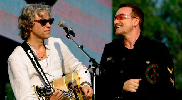 Bono (R) and Bob Geldof performs on stage during the 'Music And Messages' concert on June 7, 2007 in Rostock, Germany