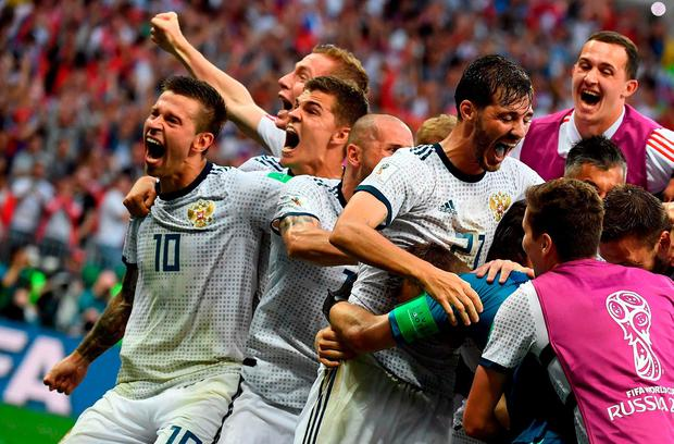 Russia's players celebrate their victory at the end of the Russia 2018 World Cup round of 16 football match between Spain and Russia at the Luzhniki Stadium in Moscow