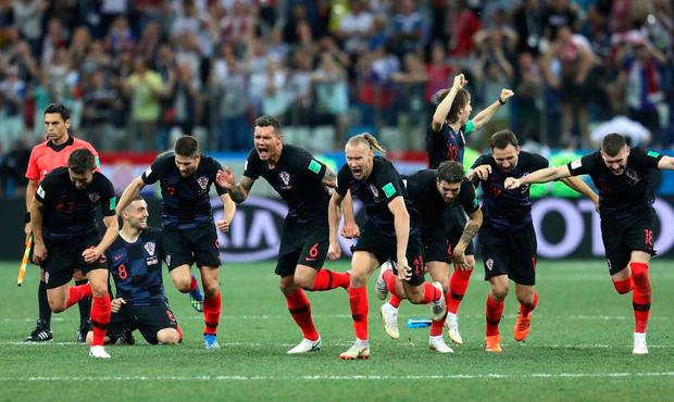Croatia players celebrate following their sides victory in a penalty shoot out against Denmark at Nizhny Novgorod Stadium on July 1, 2018 in Nizhny Novgorod, Russia. (Photo by Richard Heathcote/Getty Images)