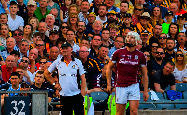 Kilkenny manager Brian Cody and Galway's Joe Canning watch a late free sail over the bar. Photo: Sportsfile