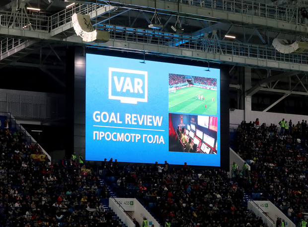 A view of the scoreboard during a VAR review after Iago Aspas had a goal initially ruled out for offside for Spain against Morocco in Kaliningrad