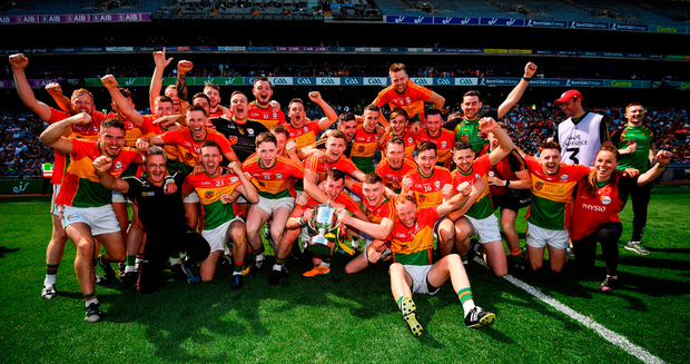 Carlow players celebrate with the Joe McDonagh Cup. Photo: Sportsfile