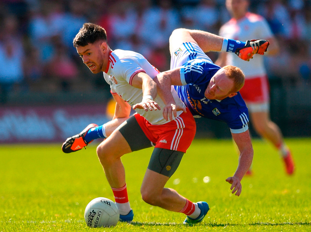 Matthew Donnelly of Tyrone in action against Cian Mackey of Cavan. Photo: Sportsfile