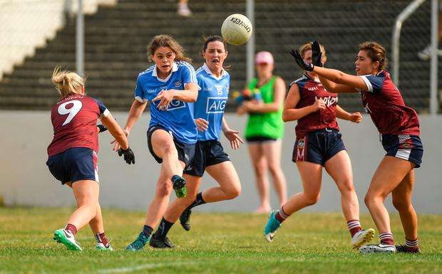 Noëlle Healy of Dublin shoots under pressure from the Westmeath defence. Photo: Sportsfile