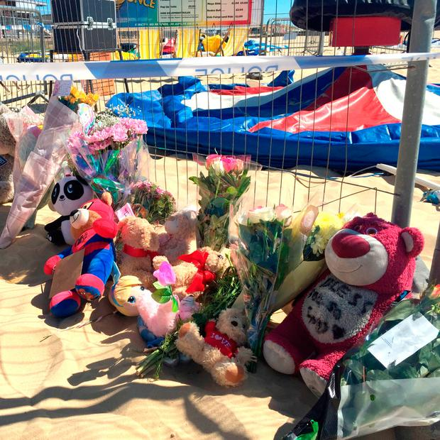 Floral tributes left at Gorleston beach in Norfolk where a girl was fatally injured: Sam Russell/PA Wire