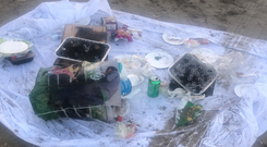 One group of people simply walked away and left everything - two used barbecues, uncooked meat, cans and packaging - behind on Laytown beach last weekend. Photo: Lisa McCabe