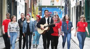 Acclaimed musician, song writer and actor Ryan O'Shaughnessy with guitar is joined by young people from Dublin Inner City and Belfast City in Temple Bar at the launch of #YouthEmpowered 2018. Photo: Leon Farrell/Photocall Ireland.