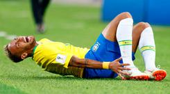 Brazil's Neymar grimaces in apparent pain after a tackle at the World Cup. (AP Photo/Matthias Schrader)