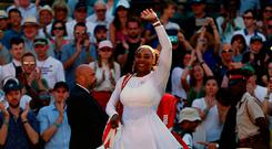 Serena Williams celebrates her win against Arantxa Rus on day One of the Wimbledon Championships at the All England Lawn Tennis and Croquet Club, Wimbledon. Monday July 2, 2018. Nigel French/PA Wire.