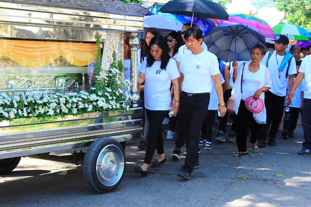 The parents of Jastine Valdez follow her coffin to the funeral service at St Joseph's Catholic Church in Aritao, Nueva Vizcaya, the Philippines. Photo: Leander C Domingo/The Valley Journal