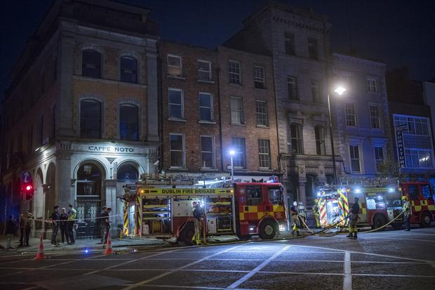 Dublin Fire Brigade tend a fire in a basement of a building on Thomas street Picture: Arthur Carron