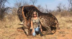 Tess Thompson Talley with the giraffe she killed