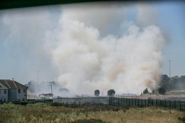 A gorse fire in a field on the Oscar Traynor Road in Coolock which affected the visibility on the M1 motorway. Photo: Kyran O'Brien