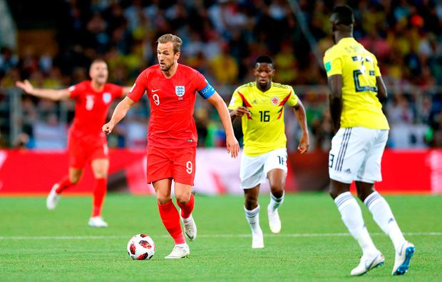 England's Harry Kane (second left) holds off Colombia's Jefferson Lerma and Davinson Sanchez (right) during the FIFA World Cup 2018, round of 16 match at the Spartak Stadium, Moscow. Picture date: Tuesday July 3, 2018. Tim Goode/PA Wire.