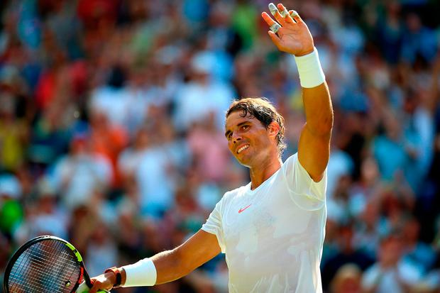 Rafael Nadal celebrates after his win against Dudi Sela at Wimbledon. Photo: Nigel French/PA