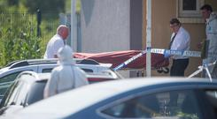The remains of Joe O'Callaghan are brought from his home in Douglas, Cork. Photo: Michael MacSweeney/Provision